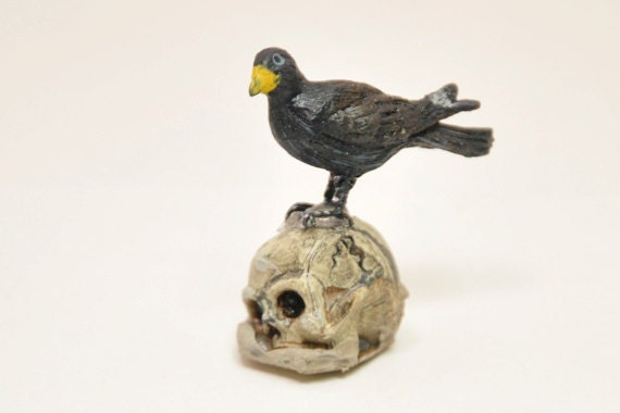 Black Crow resting on Skull 1-inch scale dollhouse miniature