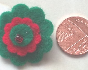 Small felt flower brooch in green and red