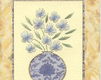 Greetings card with flowers in a vase design