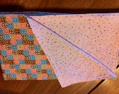Large recieving blanket swaddler in Pink, brown & blue circles and squares