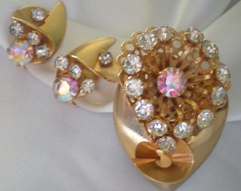 Art deco brooch and clip earrings with clear and pink rhinestones