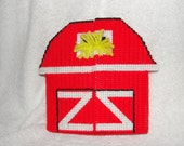 Red Barn with 4 soft animal puzzles inside made with plastic canvas and yarn in a variety of bright colors