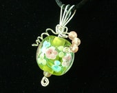 Pendant with pink and green flowered glass bead wrapped in sterling silver with small cherry quartz beads.....11-PSGL-102