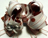 CLEARANCE- Candy stripe and polka dot multi layered boutique bow. Red, white, and silver. Holiday