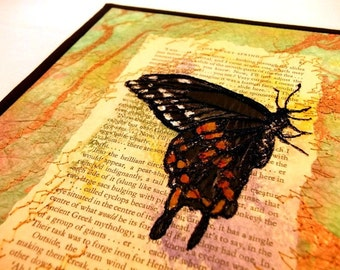 "Art quilt, butterfly thread sketch on book page and Thai marbled paper, free-motion quilted, 8""x10"""