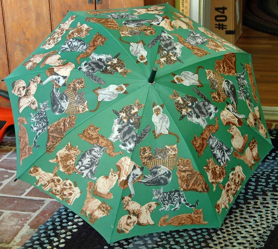 Beautiful Umbrella Covered with CATS on a Green background