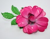 A lovely large metal vintage flower brooch, old fashioned wild dark pink rose, green leaves.