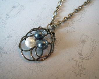 Large Circle pendent with teal and white pearls
