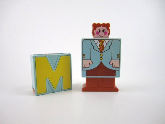 RESERVED--Plastic Letter M--Transformer Man Toy