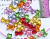 20g  of Transparent Coloured Bows (about 58 bows)