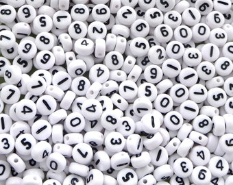 60 grams of 7 mm round white numbers beads (about 460 pcs)
