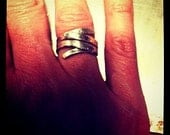 Sterling silver wrap ring.  Like a Valentine's Day  hug around your finger