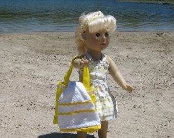 Yellow patterned sundress with  beach bag and towel