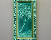 "Sculpted Tile  ""Hurricane Palm""  with Carved Shell Frame  7 1/2"" X 14 1/4"""