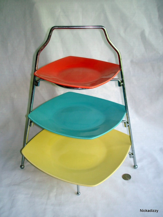 Midcentury colorful tiered serving plates on rack - yellow, turquoise and orange