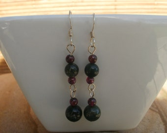 Beaded dangly earrings on sterling silver wires, moss agate and garnet