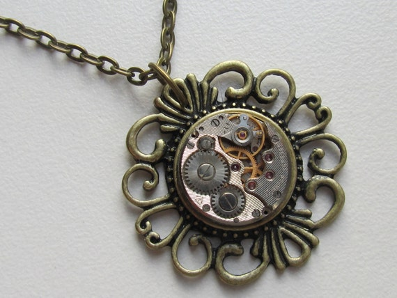 Steampunk Gothic filigree necklace with the smallest vintage watch movement. Gift under 25 Dollars, bronze necklace