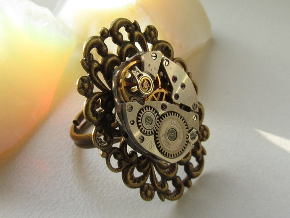 Steampunk Gothic filigree oval Ring with vintage watch movement.  Cocktail Ring under 25 dollars