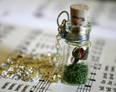 A Rose Yet To Bloom glass bottle necklace : tiny red rose and wildflower scene OOAK