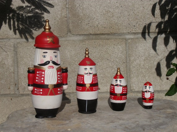 4 Christmas Hand Carved Stacking Wooden Dolls