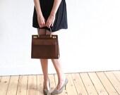 Luxury 60s vintage handbag in caramel brown leather