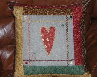 Primitive heart, applique patchwork cushion, pillow. Hand-embroidered linen.