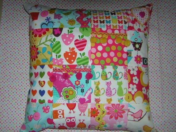 SALE... Last one. Funky, bright patchwork cushion with pompoms, beads, buttons, applique, embroidery.