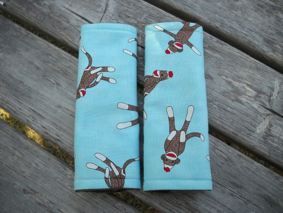 Tossed Sock Monkeys REVERSIBLE Seat Belt Covers in Aqua by Moda