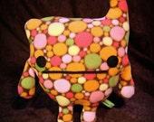 Curly, stuffed alien creature plush in spotted green, orange, pink, yellow, brown fleece Muser