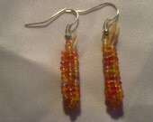 Native American square stitched fall indian corn dangle earrings with raffia husk