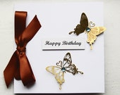 Birthday card/ Greetings Card: 3D butterflies in gold, blue heart shaped gems, chocolate satin ribbon card.