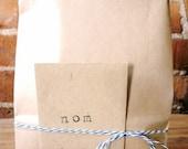 Five 1-dozen bags: 2 almond, 3 classic vanilla organic fleur de sel caramels
