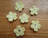 pale yellow crochet flower with diamond center