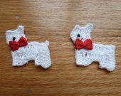fancy white crochet pups with red ribbon bow ties