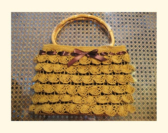Crochet lace bag with bamboo handles