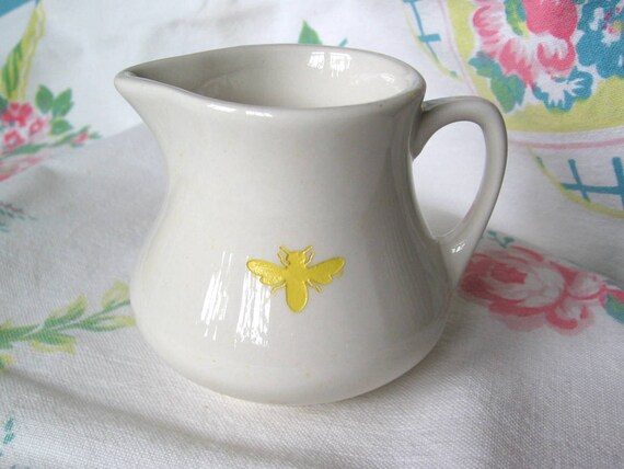 reCYCLEd cream pitcher with honeybee