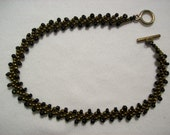 Baroness Black and Gold Bracelet
