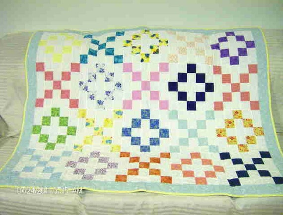 "this quilt is called ""Hugs and Kisses"" because it's made of Xs and Os"
