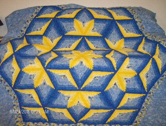 Diamond Log Cabin Star quilt in blues and yellows