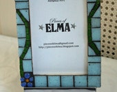 Mosaic picture frame made from glass tiles on a pine wood frame, light blue tiles with flower