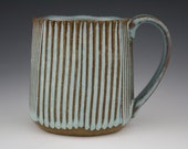 Light blue faceted mug with combed texture.