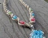 Hemp necklace with glass flower pendant and colored glass beads