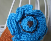 Crochet Flower Brooch, in turquoise blue with rich brown embroidery and a felt leaf.