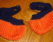Navy blue and orange knitted booties with  buttoned strap