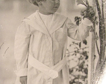 A Little Boy with Flowers  c. 1910 Photo Postcard