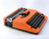 Vintage orange manual  typewriter from Europe