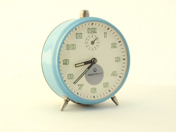 Vintage blue alarm clock made in Russia
