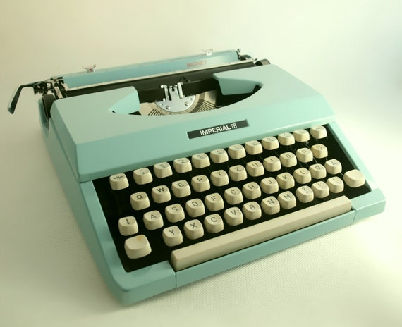 Vintage manual typewriter turquoise / aqua blue  - Imperial