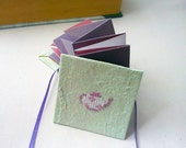 Mint green concertina book with cross stitch teapot