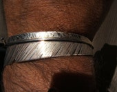 Navajo sterling Feather cuff, signed J. WOOLSEY.......unisex bracelet 5 inch ....